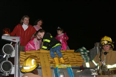 Climbing off the firetruck