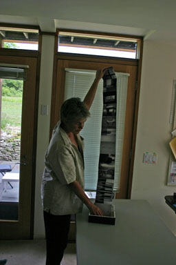 Photographer Gina Murtagh shows off a book of photos she created