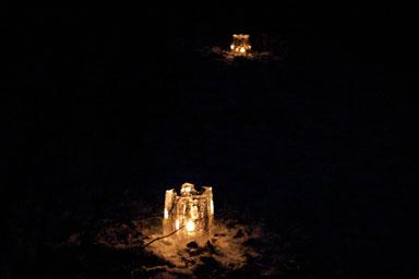 Lanterns against the dark.