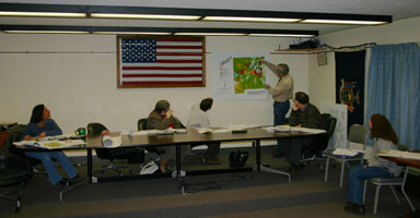 Planning Board members and planner George Frantz modify plans for Mott Road area